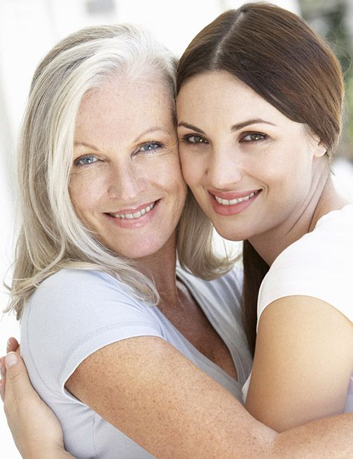 beautiful mature woman and daughter